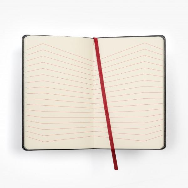 CHANGE skrivbok - svart/silver/hologram - uppslag med vågiga linjer zick-zack och månad dag överst på sidan - skrivi.se